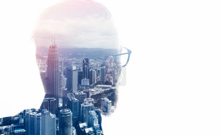 Photo of stylish bearded lawyer wearing trendy suit and looking city. Double exposure, panoramic view contemporary megalopolis background. Space for your business message. Isolated white. Horizontal