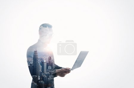 Double exposure bearded businessman wearing black shirt and glasses.Banker holding contemporary notebook hands.Work online banking.Isolated white,modern skyscraper city background.Horizontal mockup