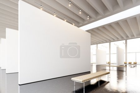 Photo for Image exposition modern gallery,open space.Blank white empty canvas hanging contemporary art museum. Interior loft style with concrete floor,light spots and generic design furniture. - Royalty Free Image