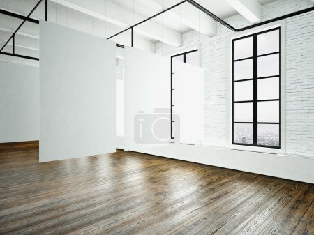 Image loft expo interior in modern building.Open space studio.Empty white canvas hanging.Wood floor, bricks wall,panoramic windows.Blank frames ready for bussiness information.Horizontal. 3d rendering