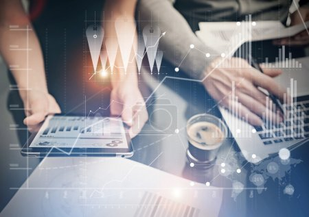 Photo for Photo female hands holding modern tablet. Finance department managers working new global project in office. Using electronic devices. Graphics icons, worldwide stock exchanges interface. - Royalty Free Image