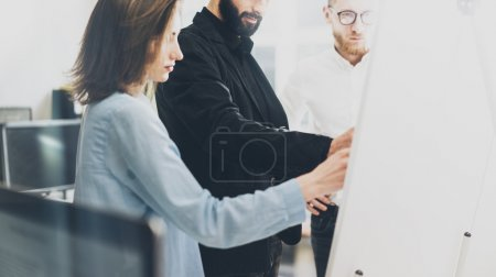 Business meeting photo.Photo man writing statistic info chart board.Photo creative department working with new startup project. Idea presentation,analyze plan,brainstorming. Film effect.Horizontal