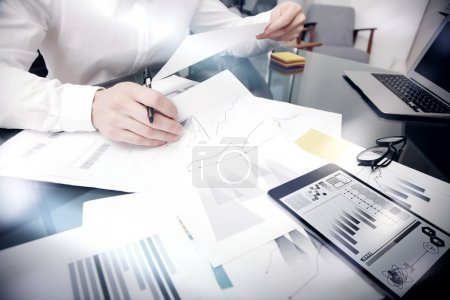 Photo pour Sales Management Work Time Process.Photo Banker working Market Report Documents Touching Screen Tablet.Using Graphics,Stock Exchanges Reports.Business Project Startup.Horizontal,. - image libre de droit