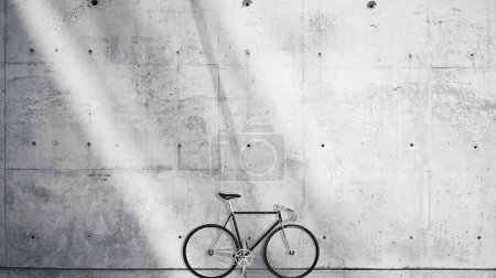 Horizontal Photo Blank Grungy Smooth Bare Concrete Wall in Modern Open Space Studio with Classic bicycle. Soft Sunrays Reflecting on Surface. Empty Abstract background.