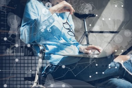 Woman Using modern Laptop Hand.Project Manager Researching Process.Business Team Working Startup Design Loft Studio.Global World Wide Icon Interfaces.Innovations Graphs.Analyze market stock.Blurred..