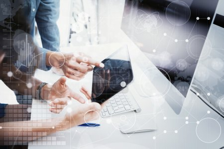 Coworkers Team Working Office Studio Startup.Businessman Using Modern Tablet,Desktop Monitor Wood Table.Bank Managers Market Researching Process.World Wide HiTech Icons Interface Screen Device Blurred