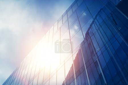 Photo for Blue glass wall of skyscraper with sun reflection - Royalty Free Image