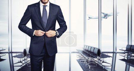 Business man at airport, cropped view...
