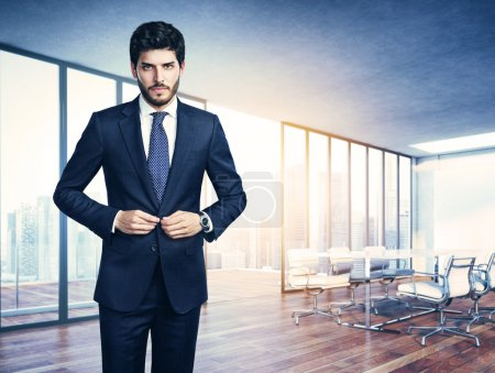 Young business man and office interior