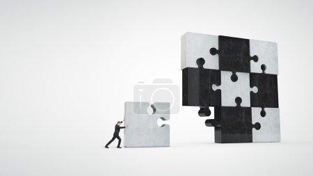 Businessman building puzzle