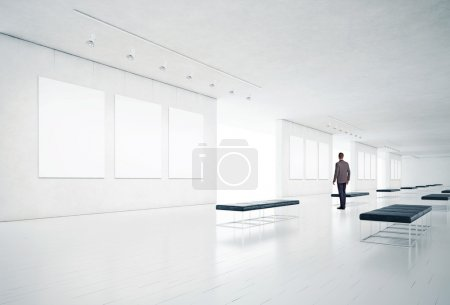 Photo for Businessman in gallery room - Royalty Free Image