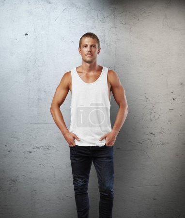 Man wearing white sleeveless shirt