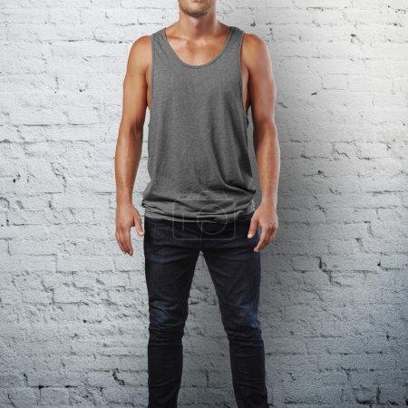 Man wearing grey sleeveless shirt