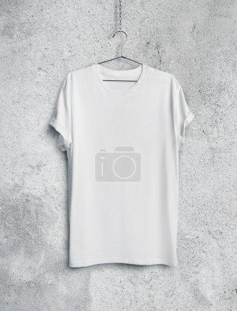 White t-shirt on concrete wall