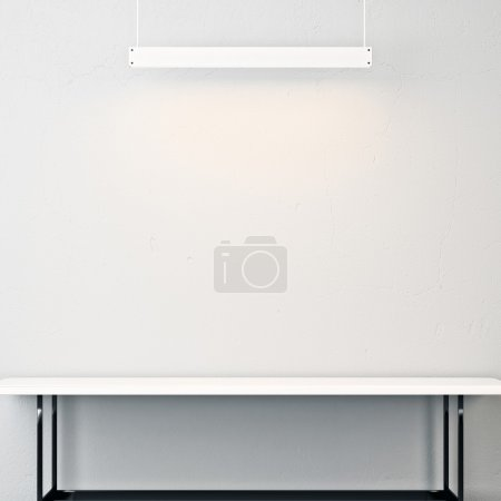 White interior with empty table and lamp