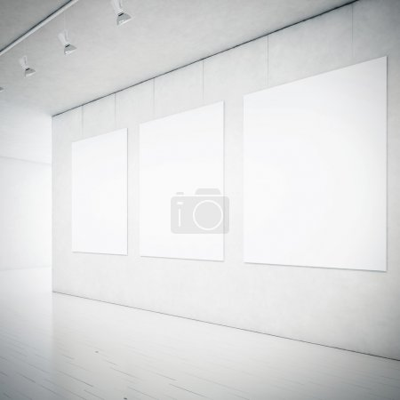 Gallery interior with blank picture frames