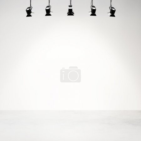 White studio background with spotlights
