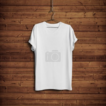 Photo for White blank t-shirt on dark wood wall - Royalty Free Image