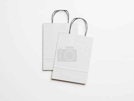 Two white paper bags with black handles