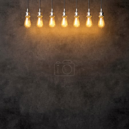 Photo for Decorative vintage lightbulbs hanging on the concrete background - Royalty Free Image