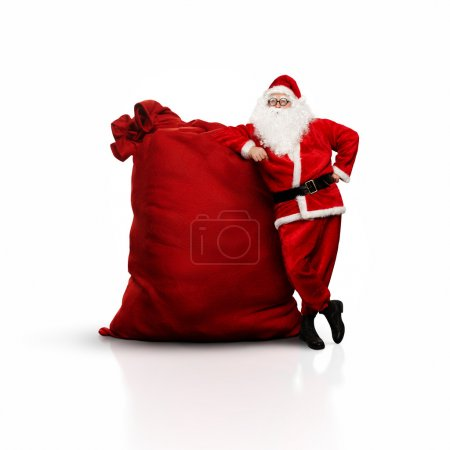 Photo for Portrait of Santa Claus with huge red sack - Royalty Free Image