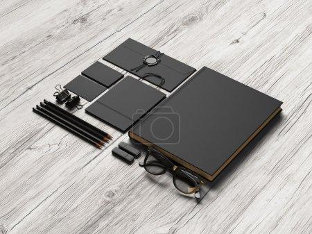 Set of black branding elements on wood