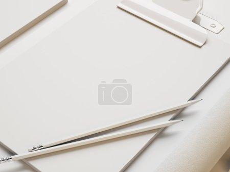 Photo pour Note blanche et éléments de marque sur fond de papier blanc - image libre de droit