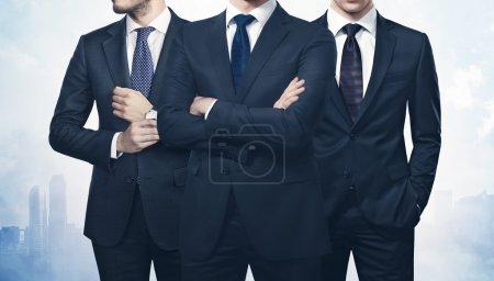 Three businessmen over megalopolis