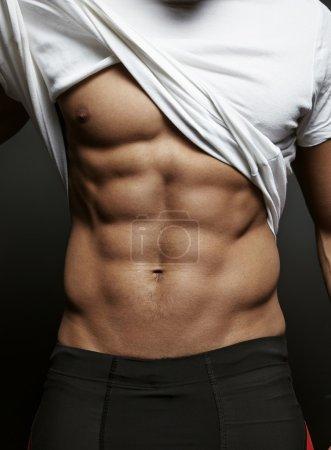 Photo pour Gros plan photo de mec athlétique avec abs parfait - image libre de droit