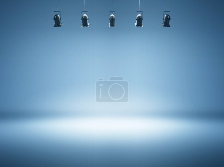 Blue spotlight with studio lamps