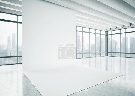 Foto de White blank background in the bright office. - Imagen libre de derechos