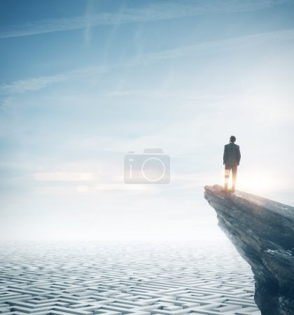 Photo for Business man standing on a rock under the labyrinth - Royalty Free Image