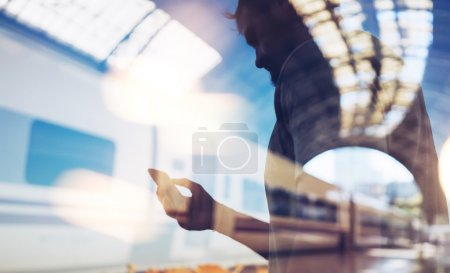 Double exposure of man and smart phone