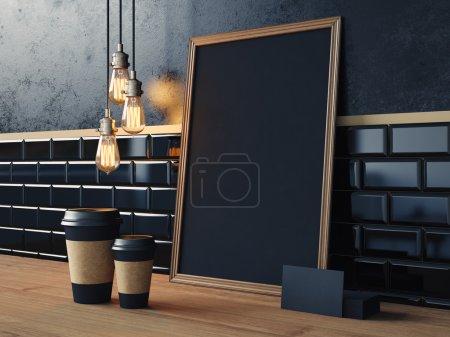 Photo pour Affiche noir sur la table avec les tasses à café blanc, cartes de visite et lampes vintage - image libre de droit