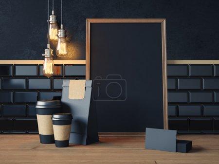 Photo pour Affiche noir sur la table avec les tasses de café noir, des cartes de visite et des lampes vintage - image libre de droit