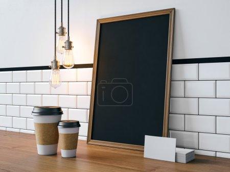 Photo pour Affiche noir sur la table avec les tasses de café blanc et cartes de visite - image libre de droit