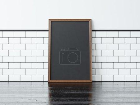 Photo pour Cadre blanc noir sur le sol noir et mur blanc sur le fond - image libre de droit