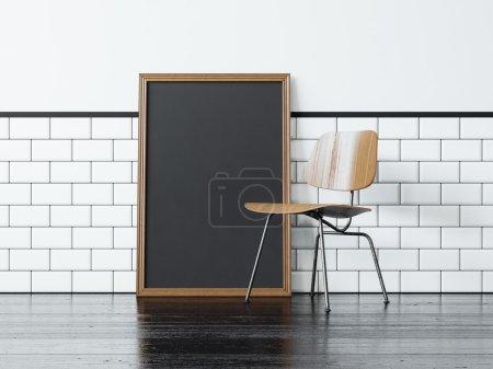 Photo pour Cadre blanc noir près du mur vintage chaise et blanc sur le fond - image libre de droit