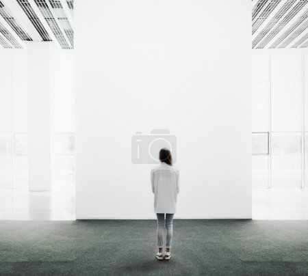 Young woman walking through a gallery