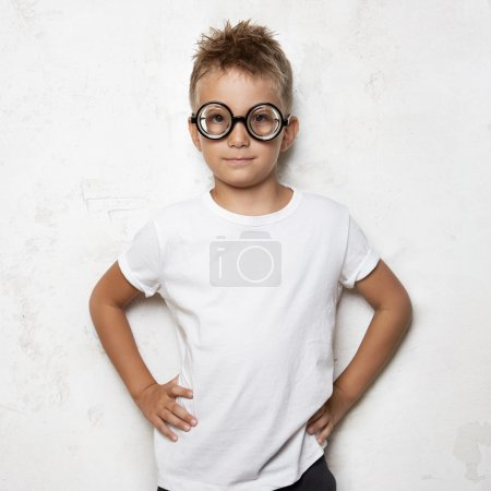 Young boy wearing funny sunglasses