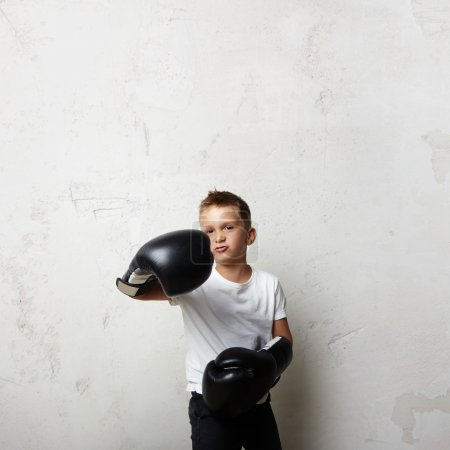 Young boxer in boxing gloves