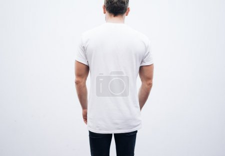 Man wearing tshirt and blue jeans
