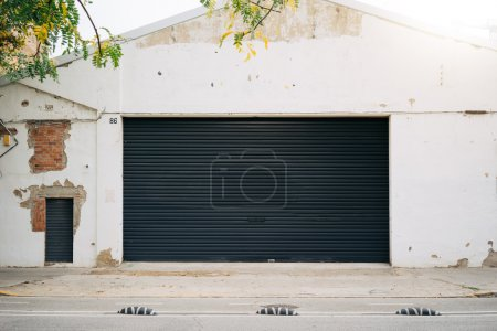 Photo for The photo of a house facade with a black shitter door - Royalty Free Image