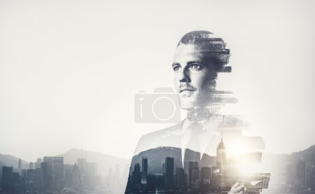 Bw multiexposure of young businessman and sunrise in contemporary city on the background