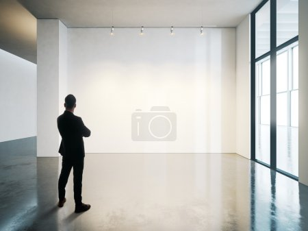 Businessman in blank museum