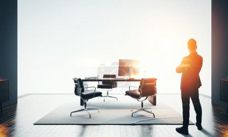 Businessman stands in modern office