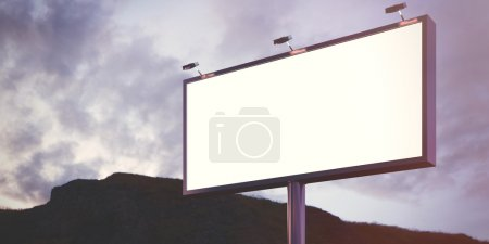 Photo for Blank billboard made of chrome metal  at twilight ready for your advertisement. - Royalty Free Image