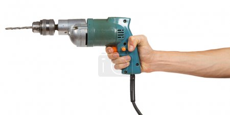Man's hand holds a drill