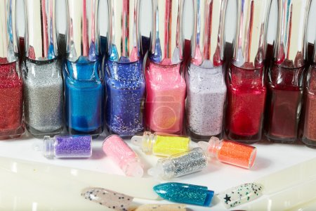 Variety of nail lacquers and accessories for manicure and pedicure