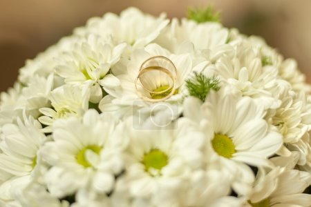 Wedding ring in a bouquet.